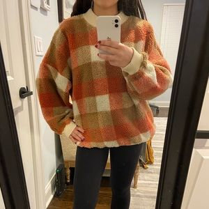 Plaid patterned sweater